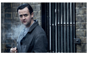 A colonial boy steps into a London pea-souper